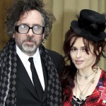Actress Helena Bonham Carter,and her husband Tim Burton, pose with her Commander of the British Empire medal, after an Investiture ceremony at Buckingham Palace in central London
