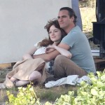 Exclusive... Joaquin Phoenix & Emma Stone Share A Kiss On Set